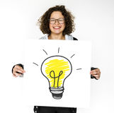 stock image of  young girl holding banner with light bulb