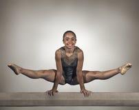 stock image of  young gymnast girl balance beam
