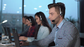 stock image of  young man in call center