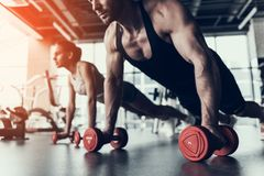 stock image of  young man and woman training in fitness club.