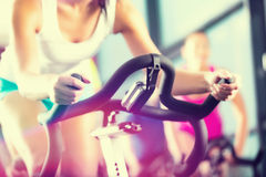 stock image of  young people spinning in the gym