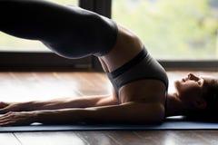 stock image of  young sporty woman doing dvi pada pithasana exercise, close up