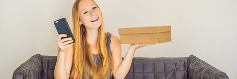 stock image of  young woman received online shopping parcel opening boxes and buying fashion items by using credit card banner, long