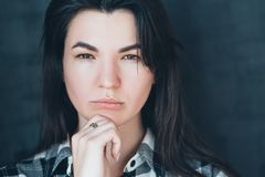stock image of  young woman suspicion skepticism doubt expression