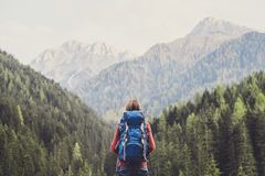 stock image of  young woman traveler in alps mountains. travel and active lifestyle concept