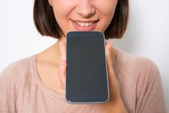 stock image of  young woman using phone vocal assistant and sending vocal message
