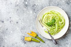 stock image of  zucchini spaghetti with basil. vegetarian vegetable low carb pasta. zucchini noodles or zoodles