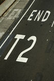 T2 end. Road and pavement detail, white line and text 'END T2 Stock Images