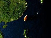 Taïwan en rouge de l'espace la nuit Photographie stock