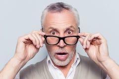 Ta av pålagda exponeringsglas Är du galen? Slut upp ståenden av shoen Arkivfoton
