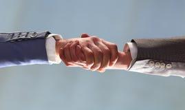 tła biznesowego uścisk dłoni odosobneni partnery biały Zdjęcie Royalty Free