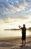 Ta en bild av en fridsam morgonsoluppgång Arkivbild