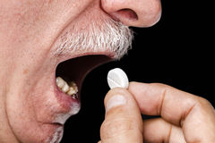 Ta en pill Arkivbild