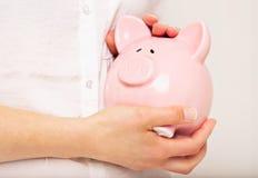 Ta omsorg av besparingar royaltyfri bild