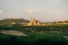 Ta Pinu Basilica, Gozo, Malta. Gozo, Malta. Our Lady of Ta Pinu Basilica viewed from Gharb village at sunset Stock Photos