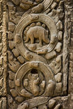 Ta Prohm temple and Bas relief  wall dinosaur Royalty Free Stock Photo