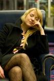 ta sig en tupplur kvinna för affär Royaltyfri Fotografi