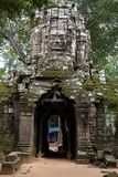 Ta Som temple. This is the gate of Ta Som temple. There is famous Khmer`s smile on the pagod Royalty Free Stock Photo