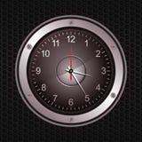 Ta tid på i en högtalare på svart metallisk bakgrund Arkivfoto