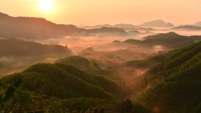 Ta tun tone din hill. Foggy morning view at sunrise. Scenic mountains, lush green complex. In Thailand stock video footage