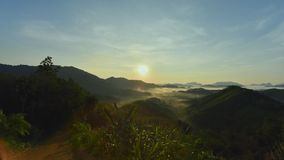 Ta tun tone din Hill.Foggy morning view at sunrise. Scenic mountains, lush green complex. In thailand stock footage