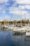 TA`XBIEX, MALTA - MARCH 9, 2018: Msida Yacht Marina with sailboats and the architecture of Ta Xbiex in the distance, at Marsamxet. TA`XBIEX, MALTA - MARCH 9 Royalty Free Stock Photography