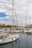 TA`XBIEX, MALTA - MARCH 9, 2018: Msida Yacht Marina with sailboats and the architecture of Ta Xbiex in the distance, at Marsamxet. TA`XBIEX, MALTA - MARCH 9 Royalty Free Stock Images