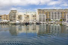 TA`XBIEX, MALTA - MARCH 9, 2018: Yachts and buildings along the coastline of Ta Xbiex, Marsamxett Harbour. TA`XBIEX, MALTA - MARCH 9, 2018: Yachts and buildings Royalty Free Stock Images
