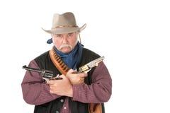 Taaie cowboy met pistolen Stock Foto