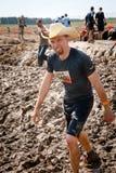 Taaie Mudder: Cowboy Mudder Runner Stock Afbeelding