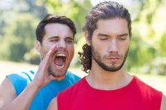 Taaie trainer die bij zijn cliënt schreeuwen Royalty-vrije Stock Afbeeldingen