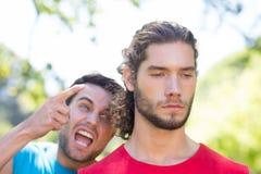 Taaie trainer die bij zijn cliënt schreeuwen Stock Afbeeldingen