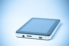 Tab device. Modern tab device on a white backgroung processed Stock Images