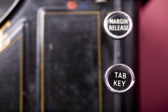 Tab Key. Old fashioned typewriter with the Tab key in sharp focus and the margin release key behind Stock Photography