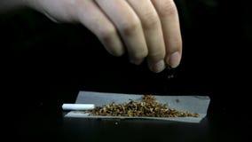 Tabac de propagation à travers le papier de roulement avec le filtre banque de vidéos