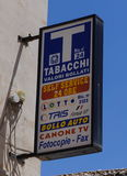 Tabacchi sign, Italy. Tabacchi denotes a tobacco shop or tobacconist in Italian. A Tabacchi sells cigarettes, bus tickets, phone cards and postage stamps. Only Royalty Free Stock Image