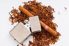 Tabacco. Lighter and cigar on white background Royalty Free Stock Photo