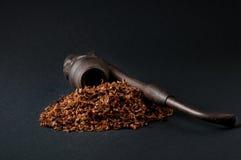 Tabacco e tubo Fotografie Stock