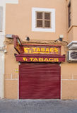 Tabacco store closed. PALMA DE MALLORCA, BALEARIC ISLANDS, SPAIN - DECEMBER 19, 2015: Tabacco store closed for the weekend with red cover on December 19, 2015 in Royalty Free Stock Photos