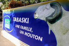 Tabaski Poster in Dakar. A poster from the Ministere de l'Elevage (Department of Livestock) in Dakar, Senegal, proclaims One Family, One Sheep, touting the Royalty Free Stock Image
