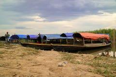 Wooden canoe in river port for transportation stock images