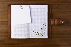 Tabbed notebook. On wood table surface. Useful for web site template royalty free stock photos