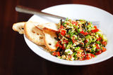 Tabbouleh with bulgur, pumpkin seeds and crackers Stock Photography