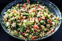 Tabbouleh made of couscous and various vegetables Stock Photos