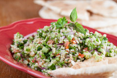 Tabbouleh with pita bread Stock Images