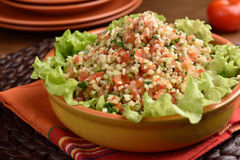 Tabbouleh on a rustic table Stock Photo