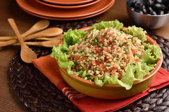 Tabbouleh on a rustic table Royalty Free Stock Photo