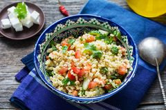 Tabbouleh salad in authentic bowl Royalty Free Stock Photos