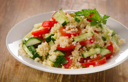 Tabbouleh salad with bulgur, parsley and fresh vegetables. Stock Photos