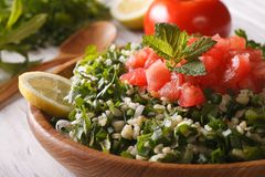 Tabbouleh salad closeup in a bowl and ingredients. horizontal Stock Image